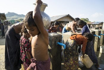 Children collect clean and safe water from a tap stand in Kyein Ni Pyin camp, home to almost 6,000 Rohingya displaced by violence in Myanmar's Rakhine state in 2012.