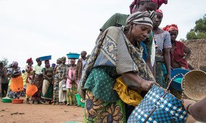 Women gather at a food distribution point in Nyanzale, North Kivu, Democratic Republic of the Congo. The distribution targets the most vulnerable households and serves around 30 per cent of all displaced families.