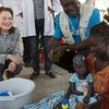 In South Sudan, UNICEF Executive Director Henrietta H. Fore (left) and UNICEF Head of Nutrition Joseph Senesie (in blue) speak with patients at Al Sabbah Hospital, where UNICEF is implementing a nutrition programme, in Juba, the capital.