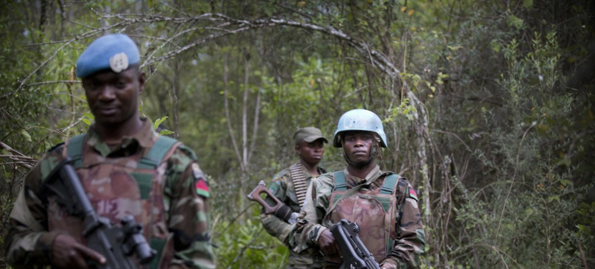 Force Intervention Brigade troops from the UN Organization Stabilization Mission in the Democratic Republic of the Congo (MONUSCO) on patrol with soldiers from the Armed Forces of the DRCongo (FARDC).