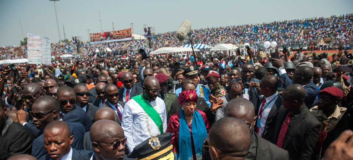 Newly appointed President of Liberia, George Weah (centre left), walks with former President Ellen Johnson Sirleaf (centre right) during the inauguration ceremony in Monrovia.