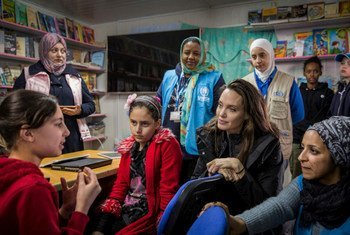 UNHCR Special Envoy Angelina Jolie talks with Syrian children at the Za'atari camp in Jordan.