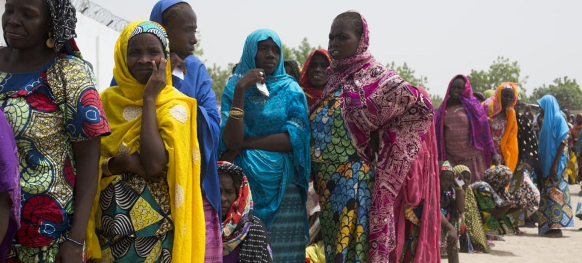 After returning to Nigeria from Cameroon, families wait to receive emergency food items, mattresses and shelter materials in Banki, in north-east Nigeria. (file)
