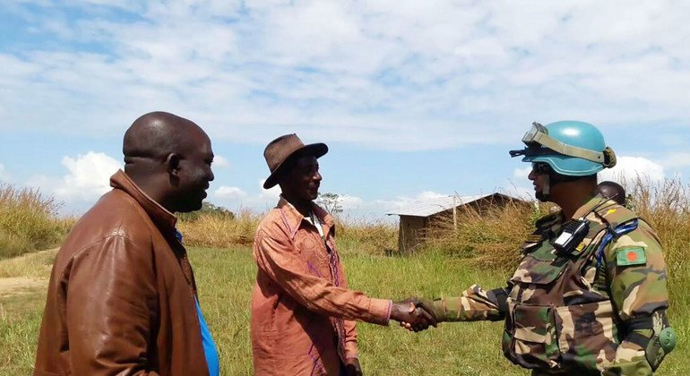 A patrol commander from the Bangladeshi battalion meets with the chief of ADA village, in the Ituri Province of eastern DRC, during a routine security patrol.
