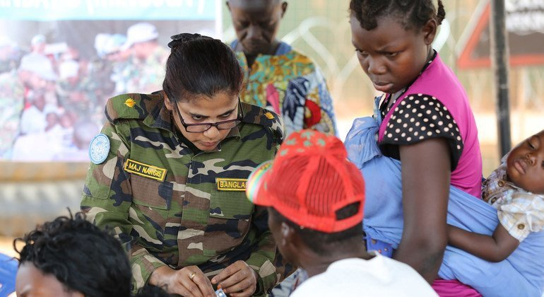 A UN peacekeeper from Bangladesh provides free medical consultations to residents of a community in the Central African Republic.