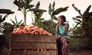 Olivia Nankindu, 27, surveys the fruits of her labor in the waning afternoon sunlight on her farm near Kyotera, Uganda.
