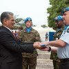 SRSG of UNMIL Farid Zarif handling flags to the UNMIL peacekeepers on the farewell ceremony in Monrovia Liberia...