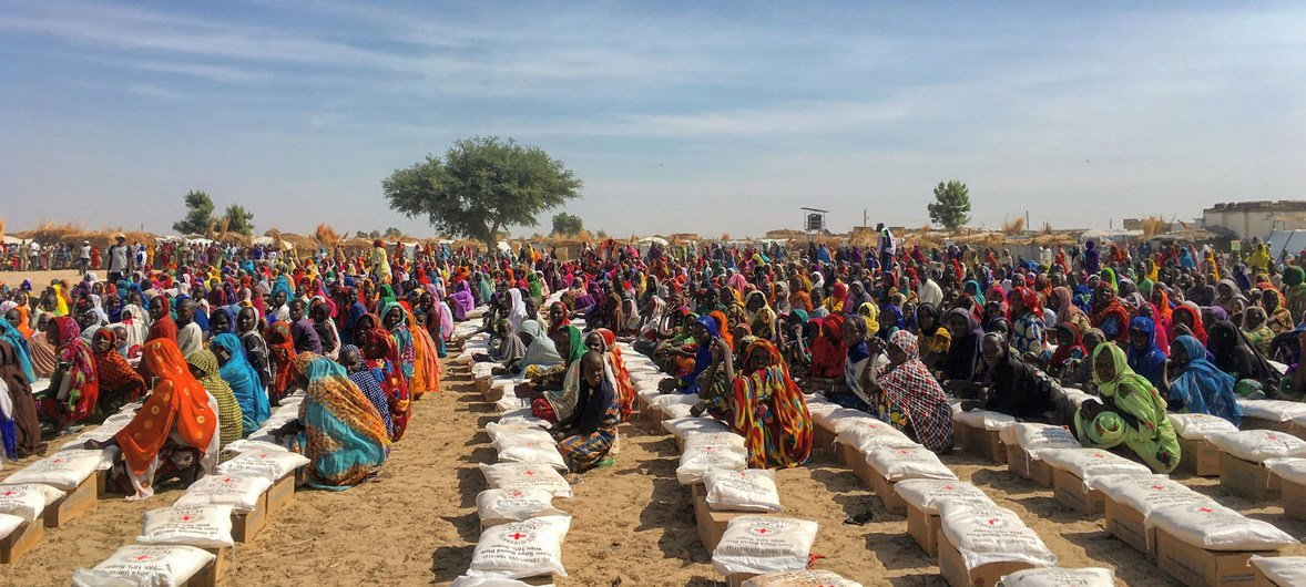 Displaced persons at a food distribution site in Rann, Borno state, north-east Nigeria.