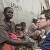 UN Deputy Emergency Relief Coordinator Ursala Mueller meets with a woman in Central African Republic who gave birth to a baby girl while she was fleeing violence to Paoua.