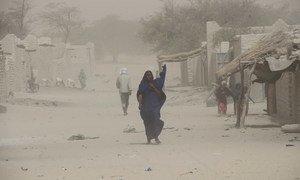 A woman walks through a village in Chad. (file)
