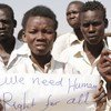 People at a Protection of Civilians Camp in Malakal, South Sudan, peacefully demonstrating and carrying signs, waiting on the side of the road for a UN convoy to pass by. (file)