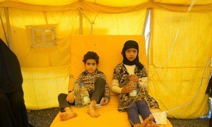 Two unrelated children, one eight and the other ten, share a bed at a cholera treatment centre in Sana'a, Yemen, due to lack of resources.