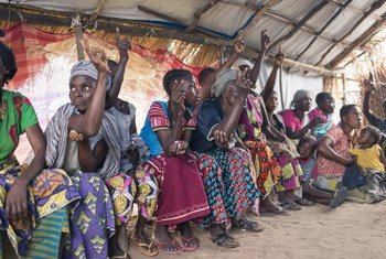 Group of Congolese women showing the number of their children who have been abducted from their families during the conflict in Tanganyika province.