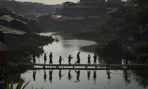 A group of Rohingya refugee children cross a makeshift bamboo bridge in Kutupalong refugee settlement in southern Bangladesh, where hundreds of thousands of refugees are sheltering after being forced to flee their homes in Myanmar.