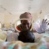 Await Said looks at her newborn grandson Ayah, who suffers from jaundice and sepsis and weighs only 1.3 kilograms, as he lies in an incubator at the Juba Teaching Hospital, Juba, South Sudan, in January 2018.