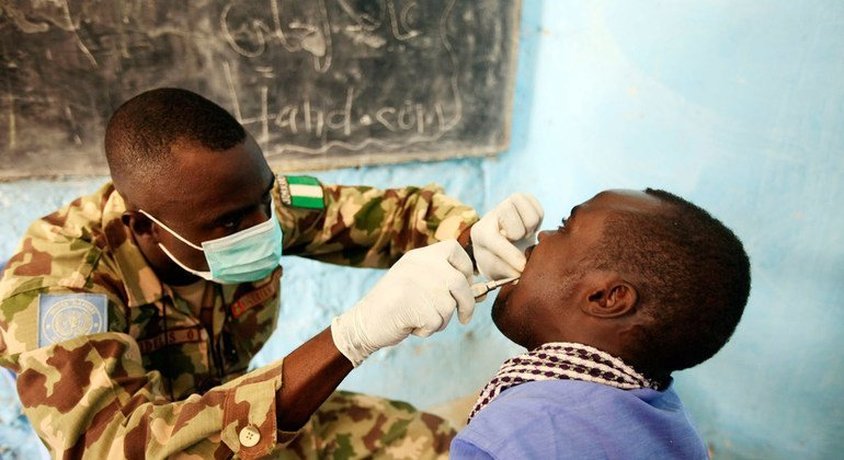 A Nigerian peacekeeper provides dental services as part of a medical camp for some 150 inmates and officials at a prison in Nyala, South Darfur.