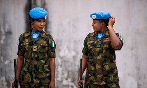 Two Nigerian female soldiers posted in the Liberian capital, Monrovia.