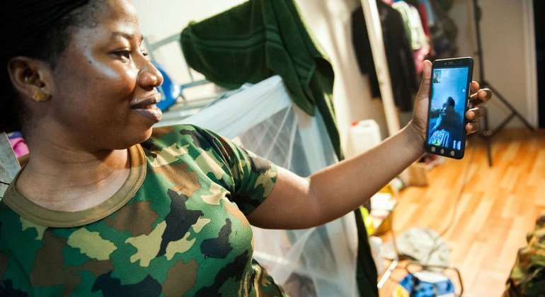 Lance Corporal Titilope Adepoju, a female peacekeeper from Nigeria posted in Monrovia, speaks with a relative on video-chat from her base.