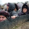People crossing the 'contact line' at Stanytsia Luhanska which is the only one operational entry/exit checkpoint in Luhansk province, Ukraine.