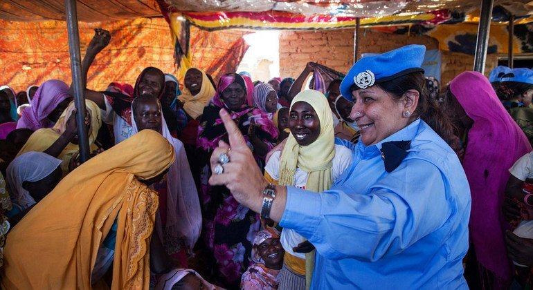 Farkhanda Iqbel, a Pakistani police officer serving with the Joint UN-AU peacekeeping mission in Sudan's Darfur region (UNAMID), attends the opening ceremony in March 2014 of the El Raman Women Shopping Centre.