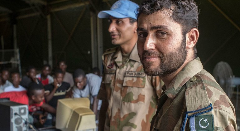 Seargent Saif (right), Signal Technician serving with the Pakistani battalion of UNMIL, along with Lt. Shafqat, conduct a five-day computer course for young Liberians in June 2013 at Camp Clara, the battalion's headquarters outside of Monrovia.