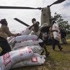Relief workers unload food aid flown in by helicopter for people affected by the 7.5 magnitude earthquake which struck Papua New Guinea in February 2018.