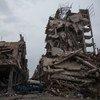 من الأرشيف: أحد المباني المدمرة في مدينة حمص. تشير التقديرات إلى أن 33% من المباني عبر سوريا قد تدمرت في الصراع.