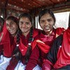 Girls who have fought child marriage go to school using a transport facility provided in the village of Berhabad, India.