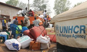 Workers from UNHCR's partner NGO load a truck with personal items belonging to refugees from Kasai Province, Democratic Republic of the Congo to take to their new accommodation at Lóvua settlement in northern Angola.