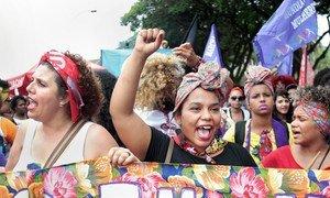 Women in Brazil march for women's rights.
