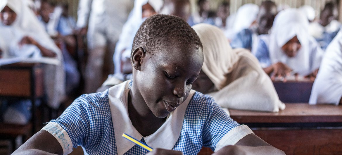 Young refugee girl sits for the end of term exams at Mogadishu Primary School in Kakuma Refugee Camp in Kenya.