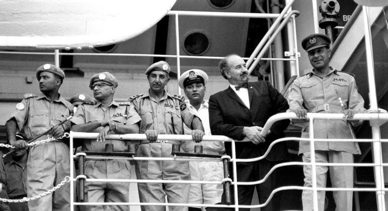 Brigadier-General Said-Uddin Khan (right), Commander-in-Chief of the UN Security Force (UNSF) George J. Janecek and several Pakistani Officers viewing the departure of about 100 Pakistani soldiers serving with the UN Security Force in West New Guinea (Wes