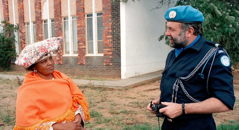 The Netherlands sent 60 police monitors to Namibia, such as the one seen here speaking to a resident in Windhoek, to serve with the UN Transition Assistance Group (UNTAG).