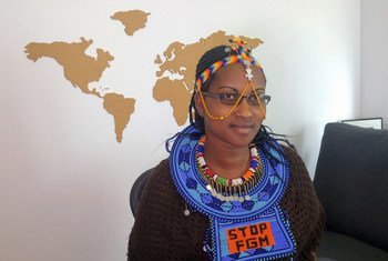"""On her Maasai beaded necklace, Purity Oyie brandishes the message """"Stop FMG"""" – female genital mutilation."""