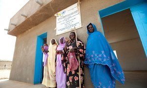 Women gather at a women's centre in Kuma Garadayat, constructed by UNAMID peacekeepers from Senegal, in 2012. This centre is one of six development projects, known as Quick Impact Projects, carried out by the Mission in the areas of education, sanitation,