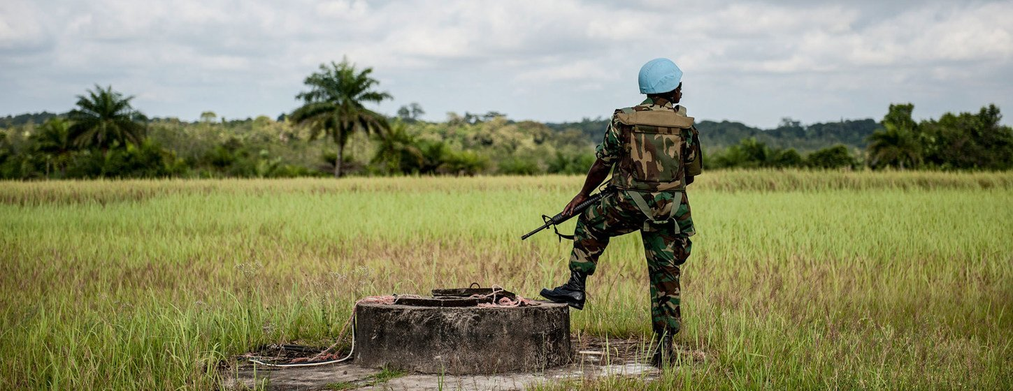 A peacekeeper from Ghana stands guard during a senior UN official's visit to Cestos City in 2012. Some 16,000 peacekeepers from over a dozen countries served in Liberia from 2003 to 2018.