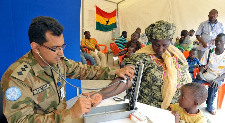 A member of the Pakistani contingent of the UN Operation in Côte d'Ivoire (UNOCI) is seen here providing medical consultations to civilians in Korhogo, in the country's Poro Region, in May 2014.