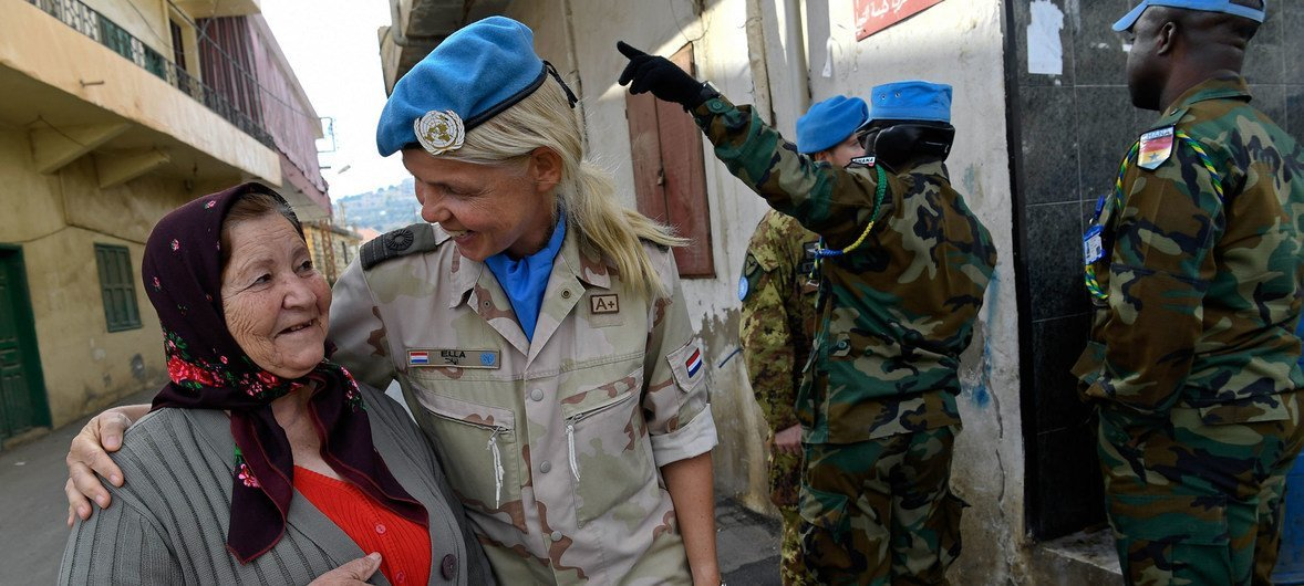 Lt. Colonel Ella Van Den Heuvel of the Netherlands interacting with a local resident while patrolling in Rmeish, South Lebanon (December 2017).