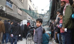 Local residents, including children, in eastern Ghouta queue for aid, March 2018