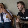 UNICEF Goodwill Ambassador David Beckham shares a laugh with 15-year-old school girl Sripun at her home in Semarang, Indonesia.