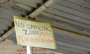 A sign posted at a health facility in rural Nepal announces no smoking.