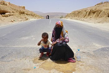 Suad, aged 18, begs in the middle of the road between Yemen's capital, Sana'a, and Saada with her four-year-old nephew, whose mother was killed in the conflict. Across the country, which has been at war since 2015, more than 22 million people need humanitarian assistance.