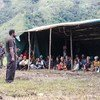 People affected by the earthquake in Papua New Guinea take shelter under a tent. Across the island nation, over 270,000 remain dependent on humanitarian assistance in the aftermath of the disaster and a series of devastating aftershocks.