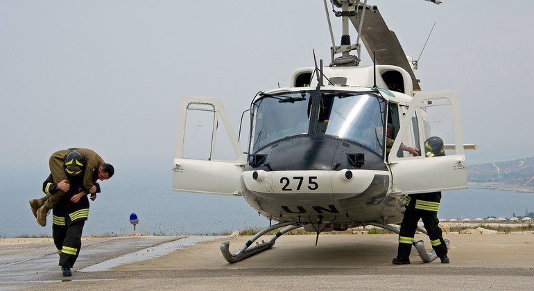 UN firefighters during an evacuation exercise at a helipad in the mission's headquarters in Naqoura in 2016. The event was organized to mark the 65th anniversary of the ITALAIR, Italy's aviation unit.