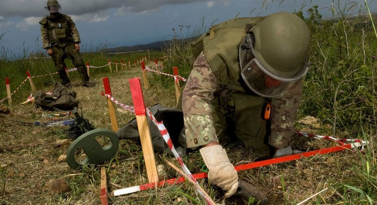 Italian deminers clear an area close to the Blue Line near Yaroun village. Mine clearance activities are vital to enabling the peacekeeping mission to deploy and carry out its operations. (8 April 2010)