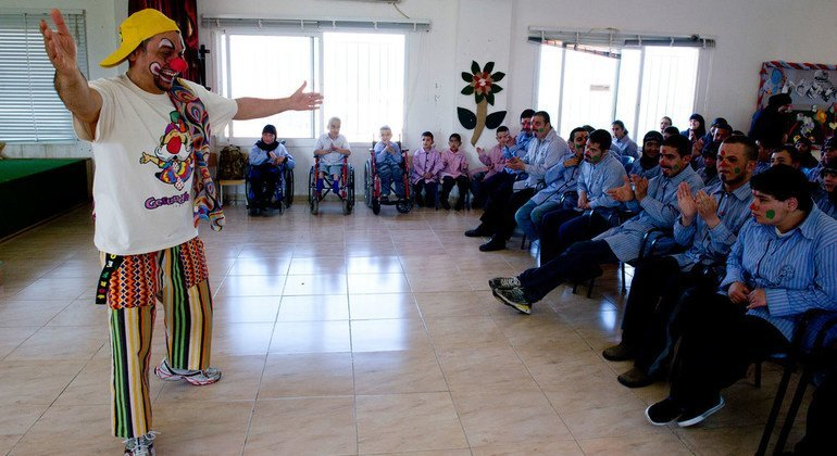 With a smile and a red nose, Warrant Officer Walter Mazzocchi (Italy) brings the healing power of laughter to students in the Ayta Ash Shaab School for Children with Special Needs. (30 March 2013)
