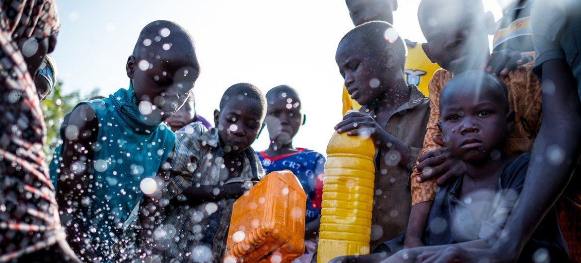 Children from displaced families collect water at a tap in Maiduguri, Borno state, north-east Nigeria. Humanitarian crisis in the region has forced hundreds of thousands from their homes and dependent on humanitarian assistance.