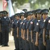 Liberian National Police officers attend their graduation ceremony. This graduating batch included 104 new female officers.