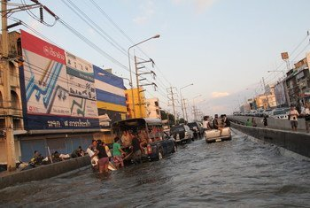 Panic-stricken residents of a suburb of the Thai capital, Bangkok, climbing aboard cars and trucks to evacuate the area.