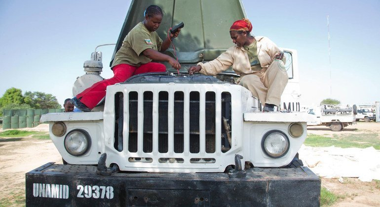 Two UNAMID mechanics from Ethiopia – Sergeant Meseret Adera and Corporal Seblewengel Demesse – repair a vehicle at a workshop at the Gereida team site in South Darfur. UNAMID deployed a battalion from Ethiopia to protect civilians in July 2012.